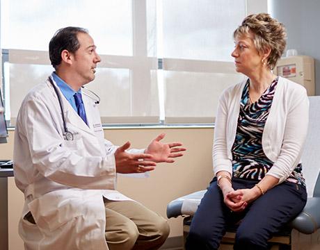 patient in exam room with doctor