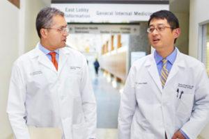 Two Doctors talking in a hallway
