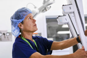 surgeon performs robotic surgery