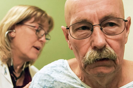 Bruce in an exam room, close up portrait