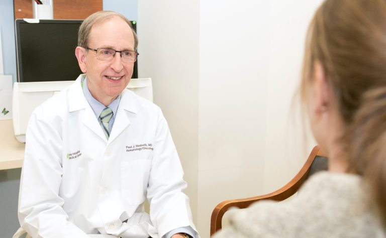 Paul Hesketh, MD with patient