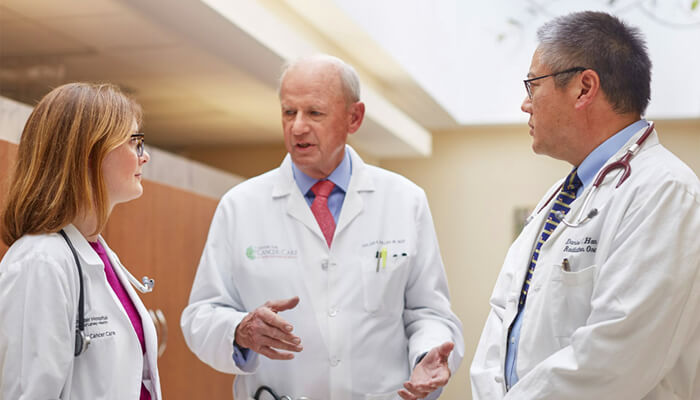 Three doctors having a discussion