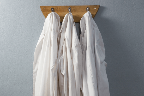 white coats hanging on coat hanger