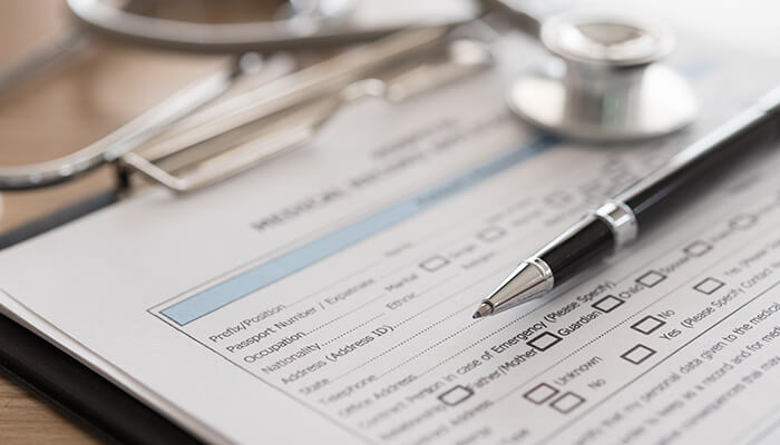 Image of a hospital form with a pen on it