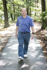 Barry walks in woods after his bariatric surgery