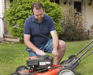 Eric Morris, Lahey patient, working on his lawn mower