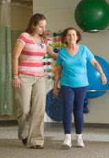 Lahey physical therapist walks with patient