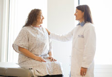 doctor talking with breast health patient for screening