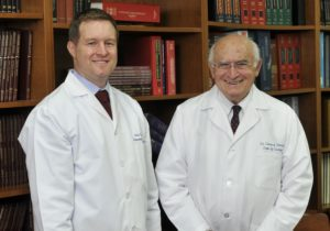 Dr.  Vanni and Dr. Zinman in a medical library
