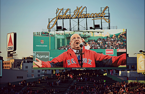 Lahey patient and cancer survivor John Lema sings at Fenway Park