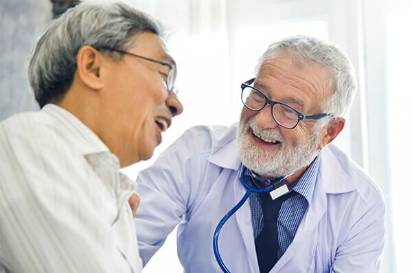 Primary care doctor jokes with patient