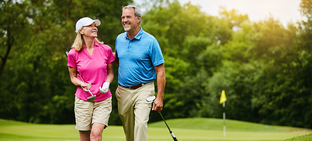 Shot of a mature couple on a golf course