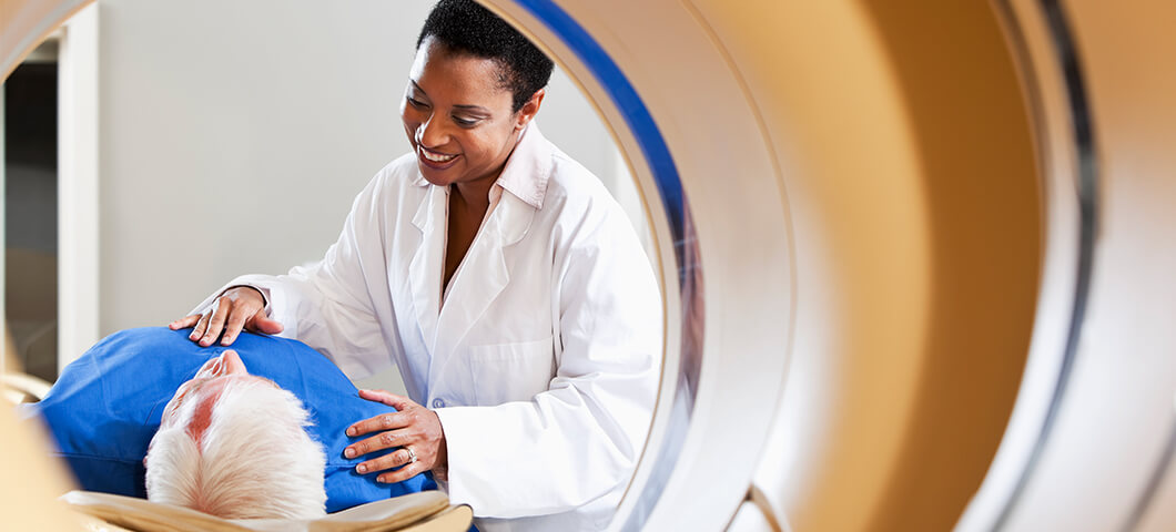 MRI technician with patient viewed from inside of MRI