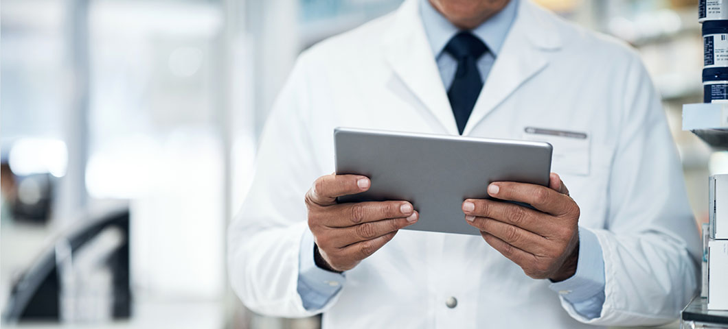 Cropped shot of a pharmacist using a digital tablet in a pharmacy
