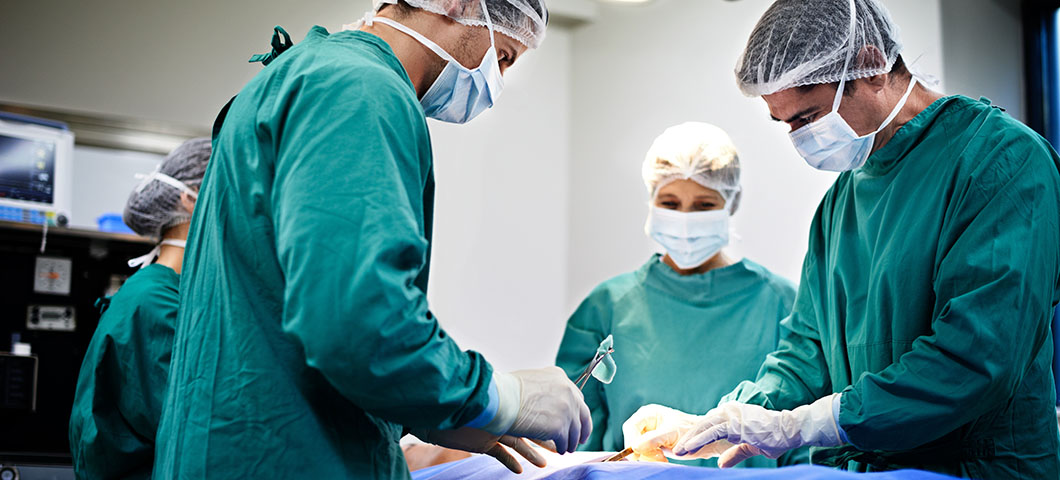 Shot of a group of surgeons working on a patient in an operating room